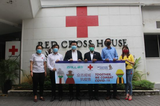 Group photo of ZALL, Singapore Red Cross, Singapore Airlines. From left: Ms Charis Chan, Associate Director of Singapore Red Cross; Mr Lee Wei Hsien, Director of ZALL Group; Mr Peter Yu, CEO of ZALL Group International; Mr. Benjamin J William, Secretary-General from Singapore Red Cross; Mr Mohamed Rafi Mar, Vice President of Singapore Airlines Cargo; Ms Iris Chong, Director of Singapore Red Cross (Photo credit: ZALL Group)