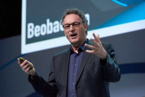 For the first time, a futurist will speak at E-Day. The